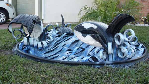 escultura creativa reciclando neumaticos