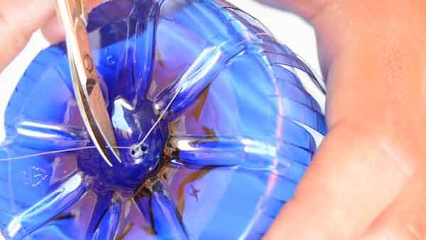 Cosido del culo de la botella para hacer el globo